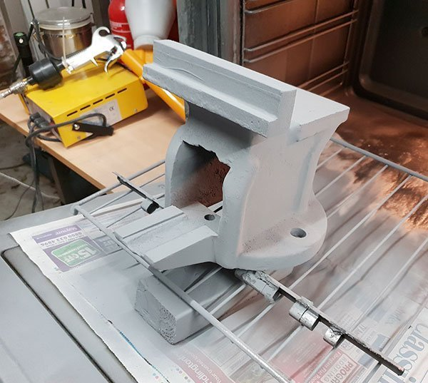 Powder coat covering the main body of the vice before going back into the oven to cure.