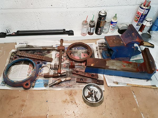 All parts of the vice cleaned with white spirit drying on the workbench.