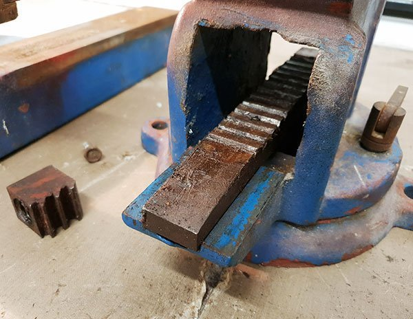 Close-up of toothed runner inside the vice that the sliding jaw grips onto.