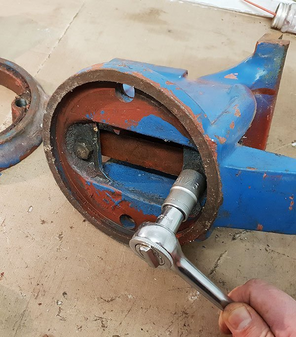 Unbolting toothed runner from the underside of the vice.