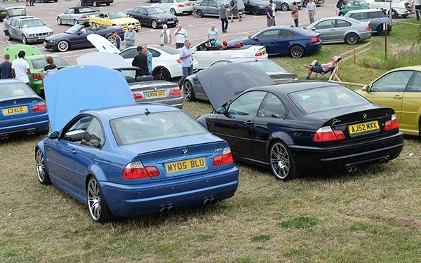 Two BMW E46 M3's with factory polished style 67 19 inch wheels.