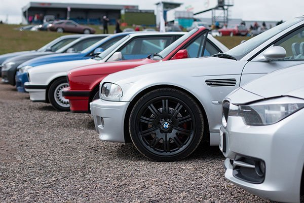 Silver BMW E46 M3 with standard front brakes parked at a show.