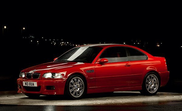 Imola E46 M3 with 18 inch wheels photographed at night.
