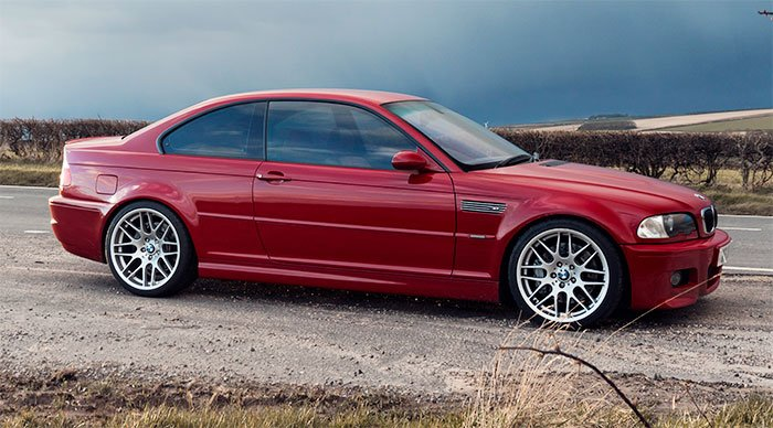 Imola red E46 M3 with CSL wheels.