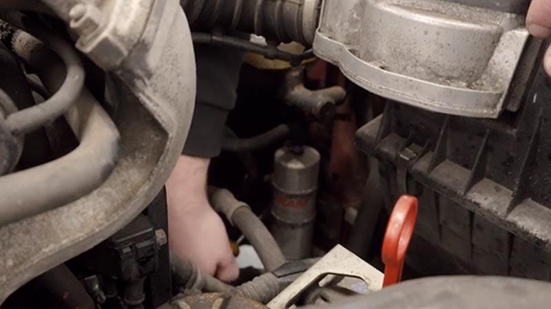 BMW E30 fuel filter location in the engine bay.