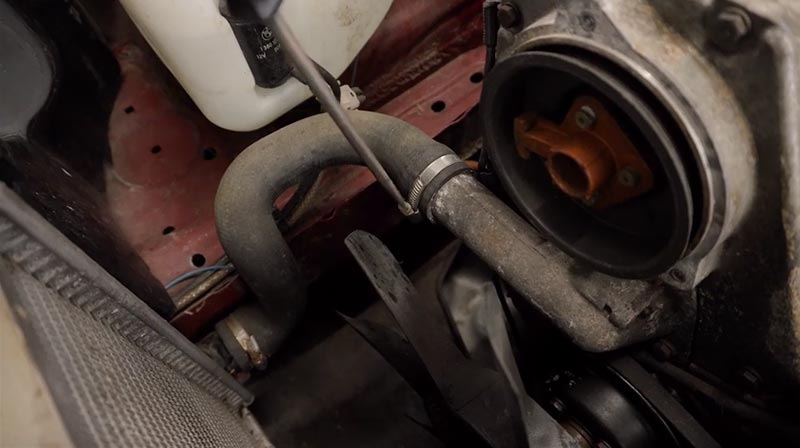 Removing a coolant pipe to drain off the coolant.