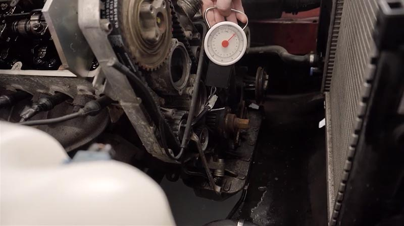Using the luggage scale to tension M40 timing belt.