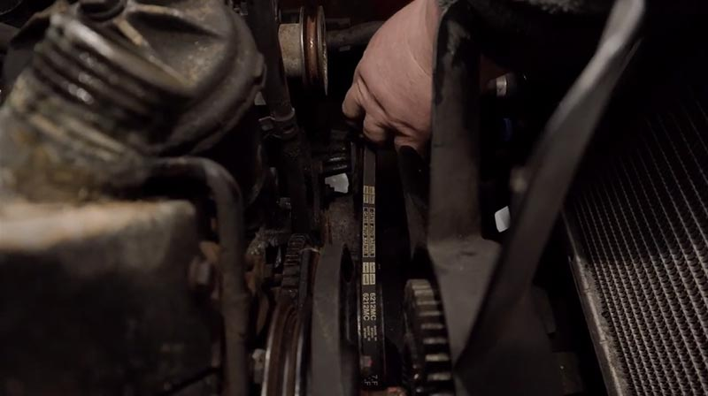 Removing the aux belts from an E30.