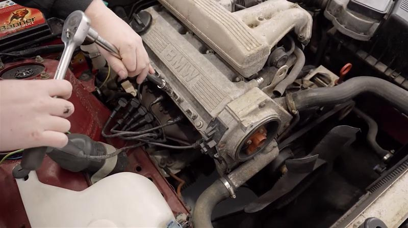 Removing the M40's valve cover.