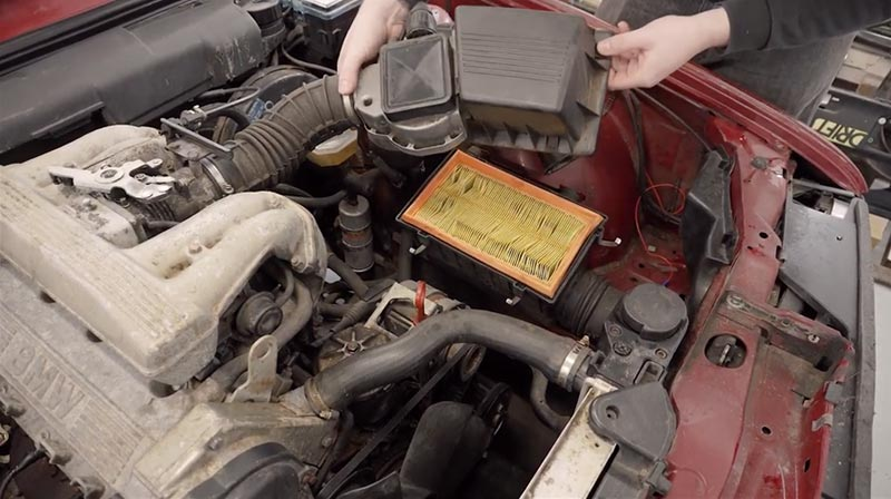 Replacing the air filter on a BMW E30.