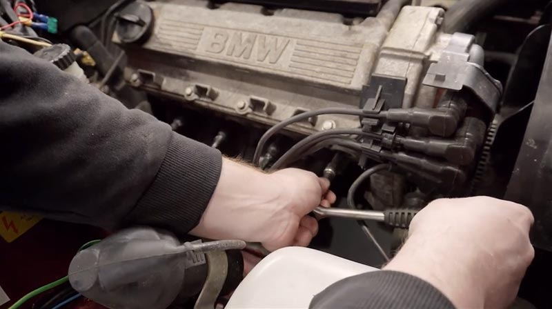 Replacing the spark plugs on a BMW M40 engine in an E30 3 series.